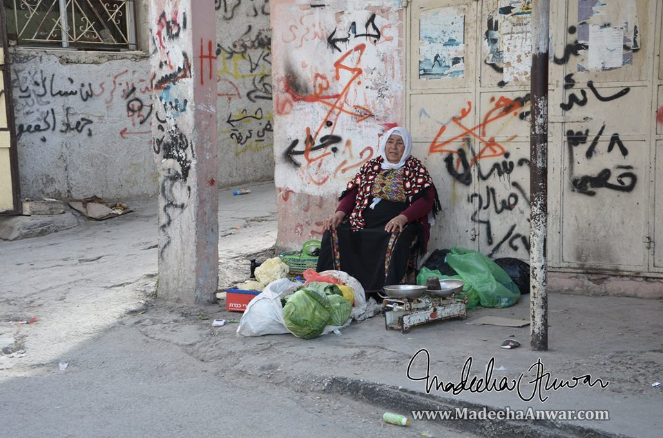 a-woman-selling-vegetables-at-a-palestinian-refugee-camp-on-our-way-to-bethlehem-palestine-madeeha-anwar-chaudhry
