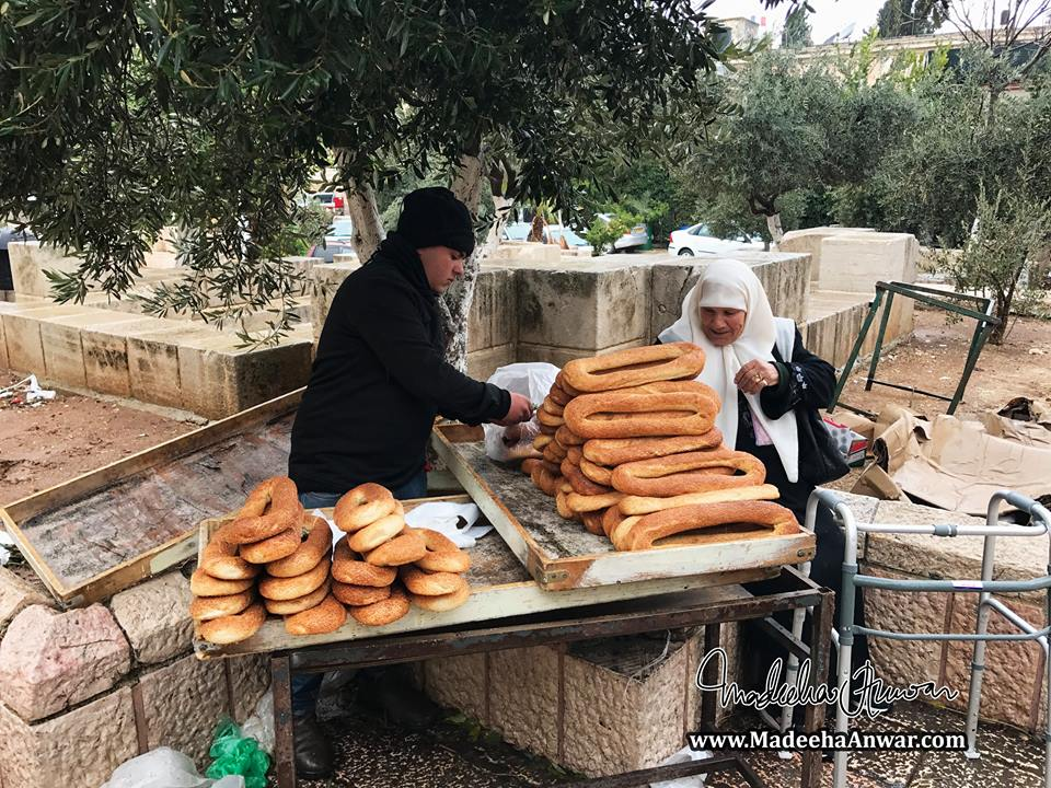 a-young-boy-selling-the-famous-jerusalembagels-outside-masjideaqsa-after-juma-prayer